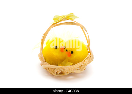 two easter chicks in a basket over white - Stock Photo