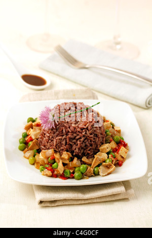 Mixed rices with tofu and mushrooms. Recipe available. - Stock Photo