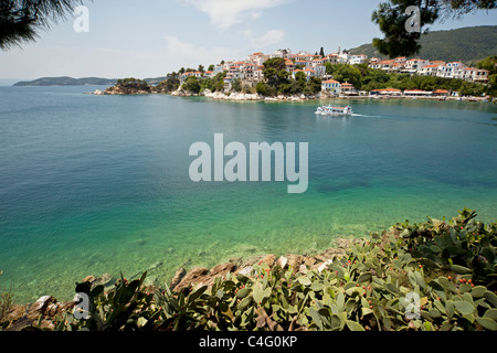 boat at the old harbour and Skiathos Town on Skiathos Island, Northern Sporades, Greece - Stock Photo