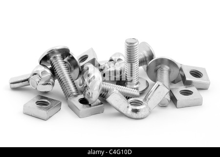 Pile of nuts and bolts isolated on a white background - Stock Photo