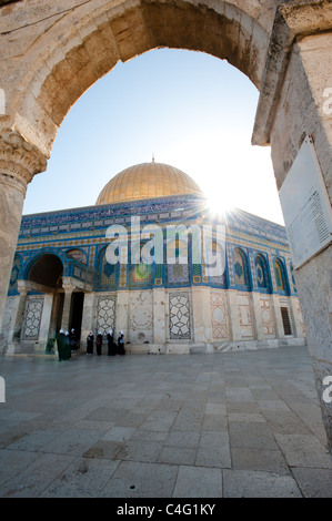 Muslim girls walk near the entrance of Dome of the Rock on the Haram al-Sharif, also known as the Temple Mount, - Stock Photo