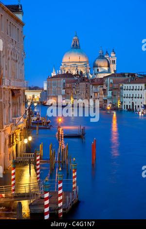 Venice, Grand Canal and Santa Maria della Salute at Dusk - Stock Photo
