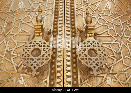 Ornamental door knockers on the gates of the Royal Palace (Dar el-Makhzen), Fez, Morocco - Stock Photo