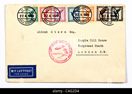 A vintage letter delivered by airship Graf Zeppelin to Hampsted Heath in London stamped 22.4.1929 celebrating airship - Stock Photo
