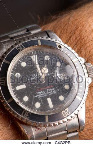 Rolex watch worn by explorer Kypros during Africa adventure  ... cracked and broken glass - Stock Photo