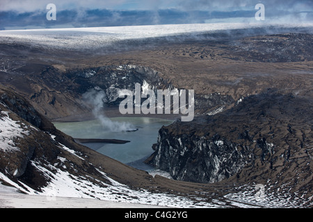 Grimsvotn crater steaming in lake, Grimsvotn volcanic eruption, Iceland - Stock Photo