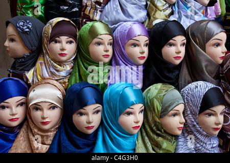 Womens headscarf display in a shop window, The Medina, Fez, Morocco - Stock Photo