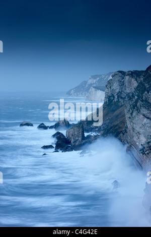 stormy seas at Lulworth Cove, Jurassic Coast, Dorset, England - Stock Photo
