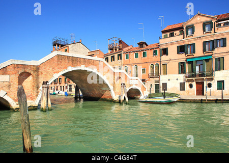 View on old multicolored houses and small bridge over canal in Venice, Italy. - Stock Photo
