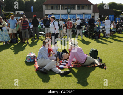Crowds enjoy hot weather and picnics at The Aegon International Tennis championships held at Devonshire Park Eastbourne - Stock Photo