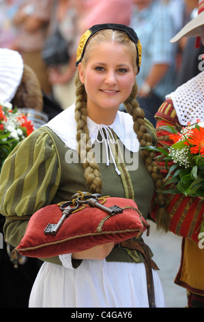 young girl as performer of the annual medieval parade Meistertrunk, dressed in historical costume in Rothenburg, - Stock Photo