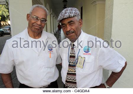 Santo Domingo Dominican Republic Ciudad Colonia Calle el Conde Peatonal Black man men uniform logo SINACHOTUPHS - Stock Photo