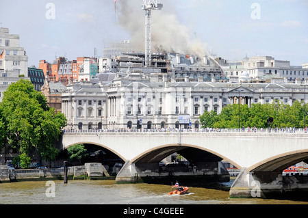 Urban London landscape skyline construction building site Marconi House roof on fire during conversion work beyond - Stock Photo