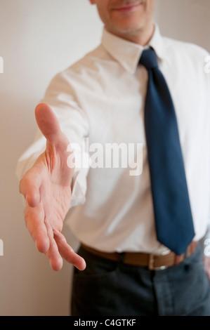 Man extending his open hand, offering handshake. - Stock Photo