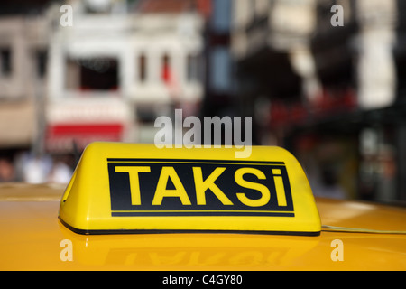 Yellow sign of the Istanbul taxi, Turkey - Stock Photo