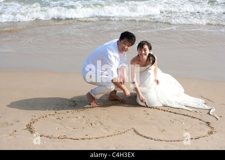 Happy Newlyweds on the Beach - Stock Photo