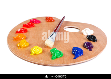 Photo of a wooden artists palette loaded with various colour paints and brush, isolated on a white background with - Stock Photo