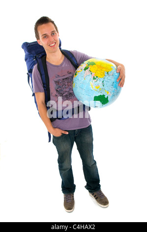 Young man backpacker with rucksack and globe - Stock Photo