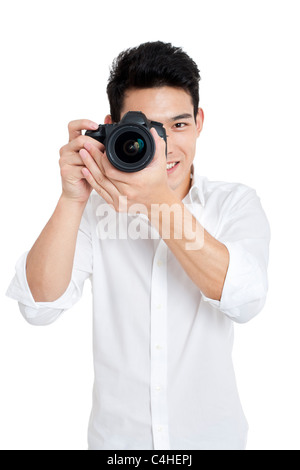 Young man taking photos - Stock Photo