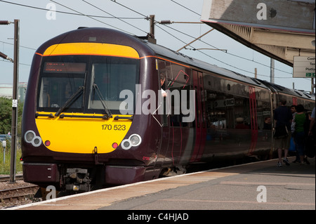 Class 170 turbostar train in Arriva Crosscountry trains livery at a railway station in England. - Stock Photo