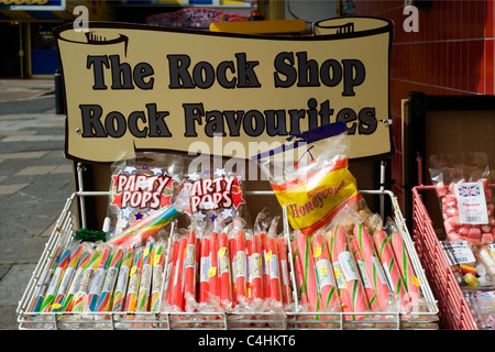 sticks of traditional rock on sale at the seaside - Stock Photo