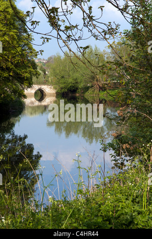 View of Barton bridge and river Avon in Bradford on Avon, Wiltshire on a bright sunny day, showing reflection - Stock Photo