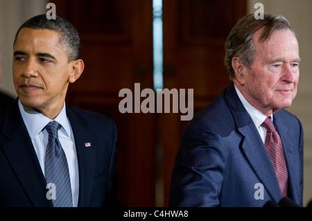 President Barack Obama presents the Presidential Medal of Freedom to former President George H.W. Bush. Stock Photo