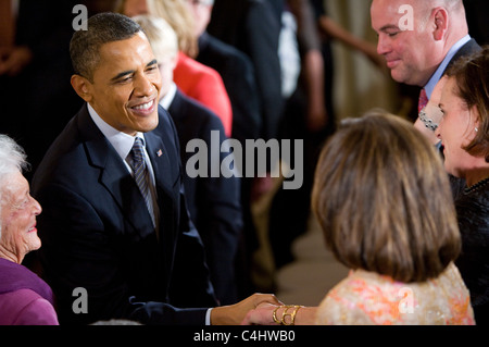 President Barack Obama shakes hands during the Presidential medal of freedom ceremony. - Stock Photo