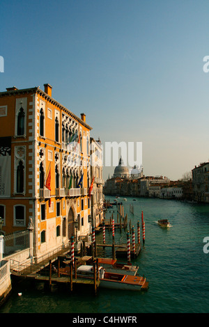 The 'Palazzo Cavalli-Franchetti' on the Grand Canal of Venice with the  'Basilica di Santa Maria della Salute' in - Stock Photo