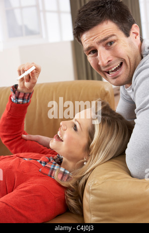 Couple Looking At Result Of Home Pregnancy Test Kit - Stock Photo