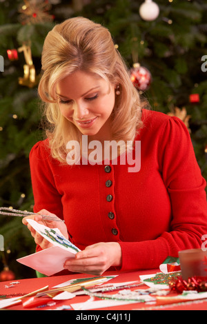 Woman Making Christmas Cards At Home - Stock Photo