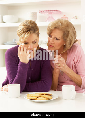 Mother Consoling Grown Up Daughter - Stock Photo