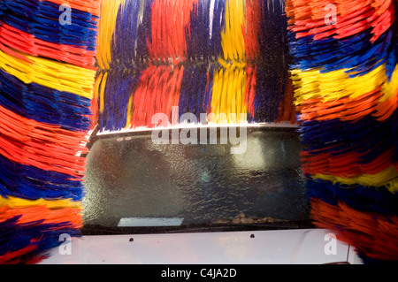 car wash carwash automatic machine brush brushes rotary revolving water spray sprayed with scratched washes carwashes - Stock Photo