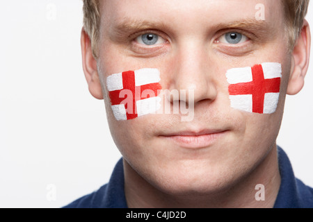 Young Male Sports Fan With St Georges Flag Painted On Face - Stock Photo