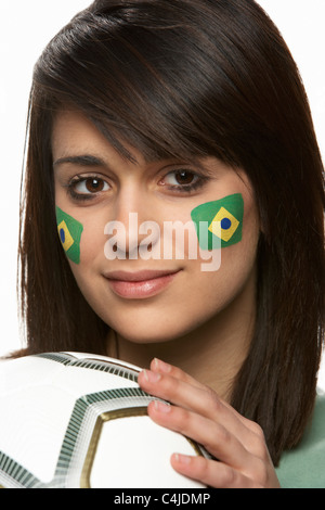 Young Female Football Fan With Brazilian Flag Painted On Face - Stock Photo