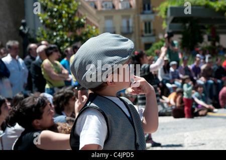 Boy dressed in chulapo - traditional costume, Plaza de la Corrala in Lavapies, Madrid, Spain - Stock Photo