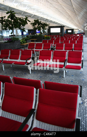 Airport Departure Lounge seating seats - Stock Photo