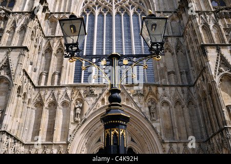 Victorian street lamps below the West window of York Minster, Yorkshire, England - Stock Photo