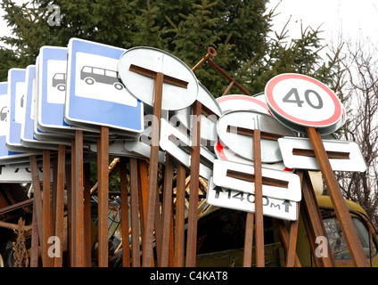 Set of different traffic signs lie in one place - Stock Photo