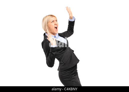 A scared young businesswoman shouting - Stock Photo