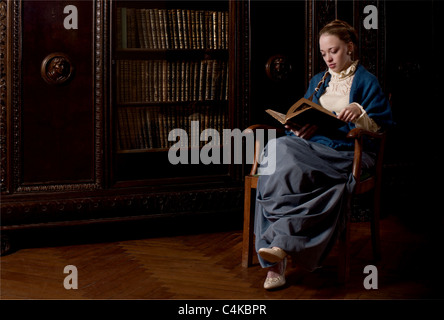 Retro style dressed women reading a book - Stock Photo