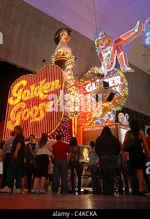 The Golden Goose and The Girls of Glitter Gulch are two famous signs along Fremont Street in Las Vegas. - Stock Photo