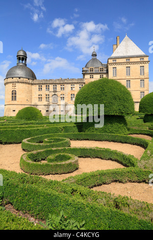 Formal French gardens with geometric Box hedges and topiary Renaiissance Chateau de Hautefort Dordogne Aquitaine - Stock Photo