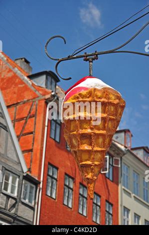 Ice cream sign outside shop, Nyhavn Canal, Copenhagen, Hovedstaden Region, Denmark - Stock Photo
