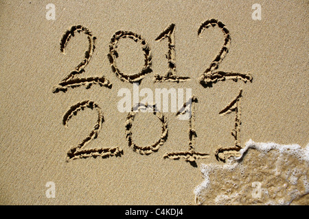 The year 2011 crossed out and 2012 coming into affect. Please see my collection for more similar photos. - Stock Photo