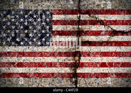 A worn and fading American flag painted on a cracked concrete surface.