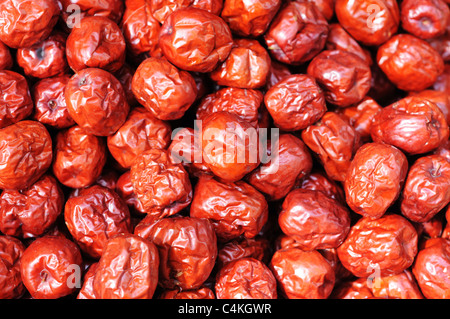 A pile of red Chinese date(or jujube) fruits in autumn. - Stock Photo