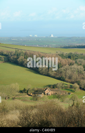 Countryside near Cothelstone, Somerset, UK, with Hinkley Point nuclear power station visible in the distance. - Stock Photo
