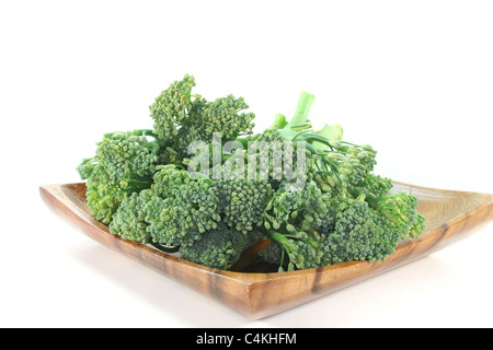 one bunch green Spargoli in a wooden bowl on a white background - Stock Photo