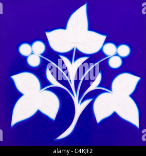 Victorian stained blue glass window tile with leaf design - Stock Photo